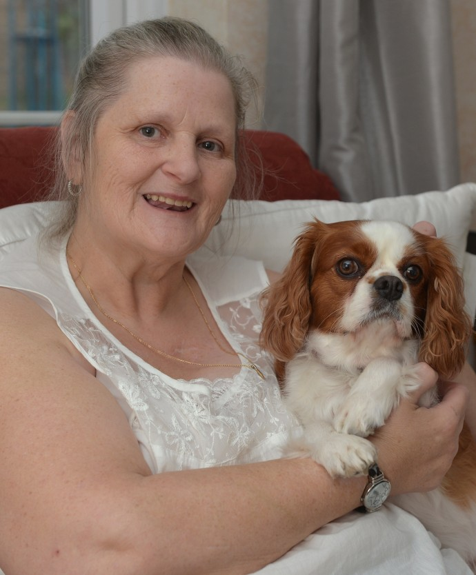 Pictured is Beau a Cavalier King Charles Spaniel who has been a rock to Marion Challis (pictured) while she battled breast cancer. Beau has health problems herself and is receiving long term treatment from PDSA in Hendon, London, for conditions including arthritis. Marion says she is hugely grateful to PDSA and claims her pet wouldn�t be here without the expert vets and nurses at Hendon. Thursday, 31st October 2014. Picture by Ben Stevens
