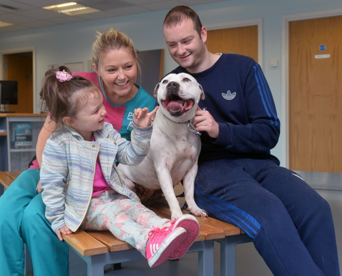 Pacemaker Press 27/5/2015 PDSA Nurse , Gemma with Eoin Murphy his daughter Alexis and with his Dog Mon after being reunited after 3 years at the PDSA building on the Shore Road in Belfast. Pic Colm Lenaghan/Pacemaker